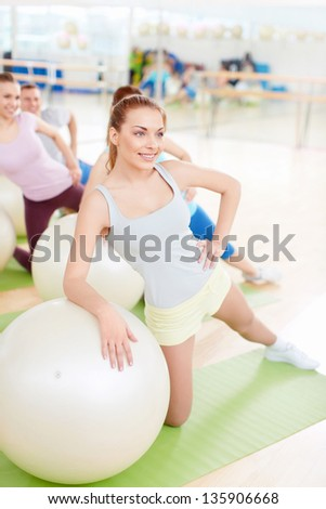 Sports people with balls in fitness club - stock photo