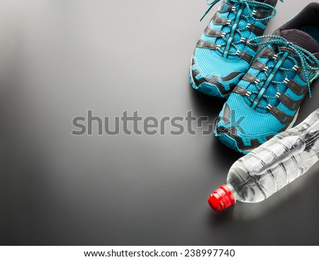 Sports runners and a bottle of water - stock photo