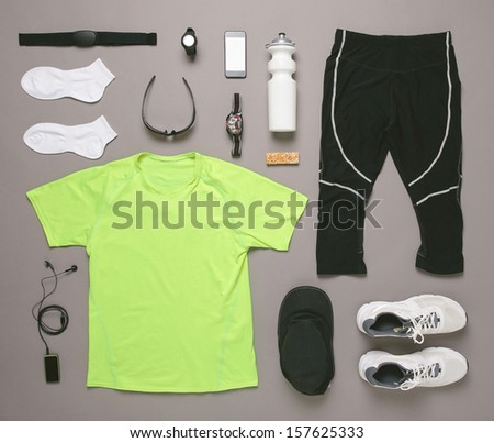 Sports set./ 	Running equipment man on grey background.