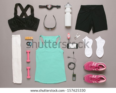 Sports set. / Running equipment woman on grey background.  - stock photo