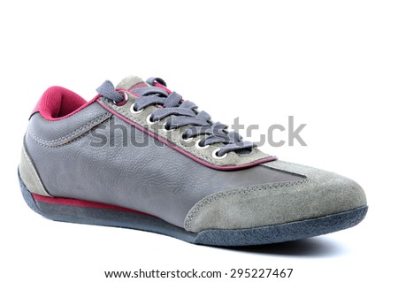 Sports shoes for young boy photographed on white background.