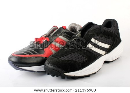 Sports Shoes On White - stock photo