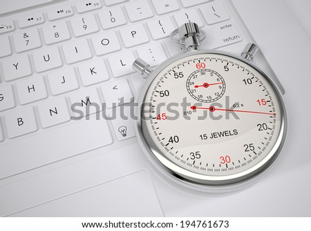 Sports stopwatch lying on a computer keyboard. View from above.