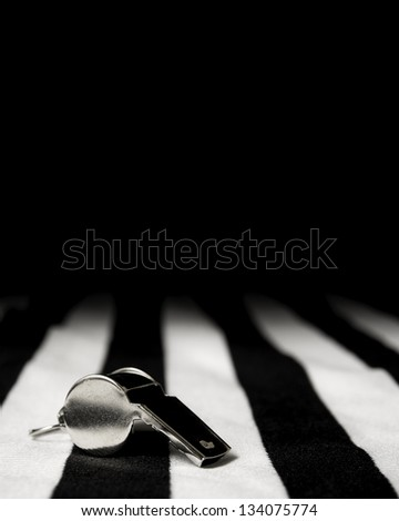 Sports team background with referee jersey and whistle - stock photo