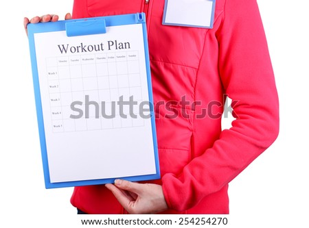 Sports trainer with personal workout plan isolated on white - stock photo