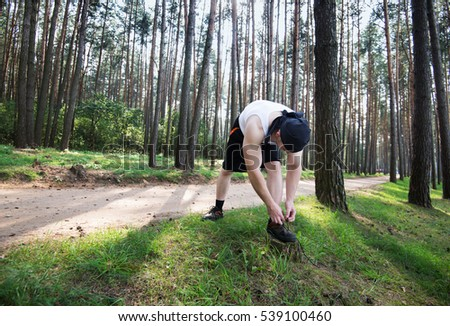 sports training outdoors guy running forest