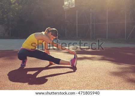 Sports Woman in sports clothes stretching after  workout