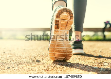 Sports Woman's legs in running movement - stock photo