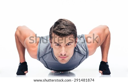 Sports young man doing push ups isolated on a white background - stock photo
