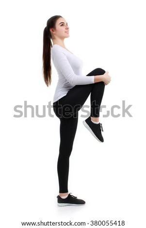 Sports young woman doing stretch exercise isolated on white background