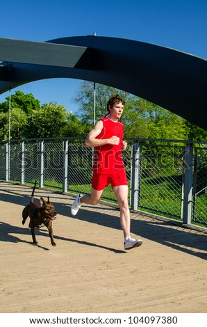 Sportsman and dog running outdoors - stock photo