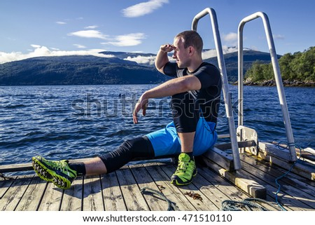 sportsman enjoys staying on the fjord, Norway
