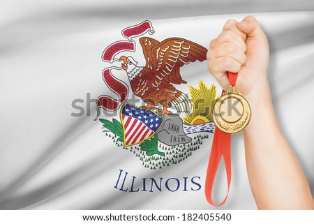Sportsman holding gold medal with State of Illinois flag on background. Part of a series. - stock photo