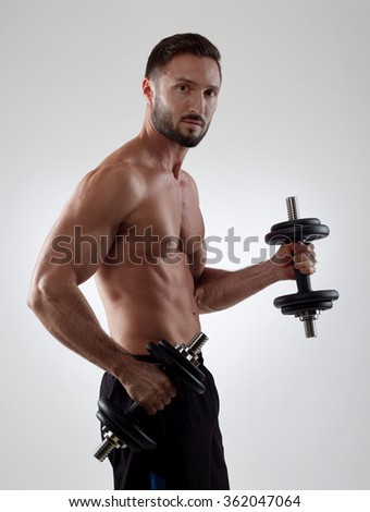 Sportsman lifting weights - stock photo
