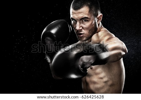 Sportsman muay thai boxer fighting in boxing cage. Isolated on black background with copy Space.