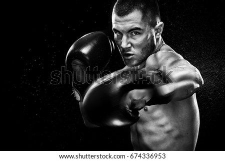 Sportsman muay thai boxer fighting in boxing cage. Isolated on black background with copy Space. Black and white photo. Sport concept.