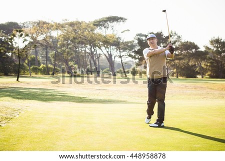 Sportsman playing golf on a field - stock photo