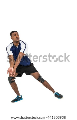 Sportsman posing while playing volleyball on white background
