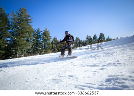 Sportsman snowboarding on the slope