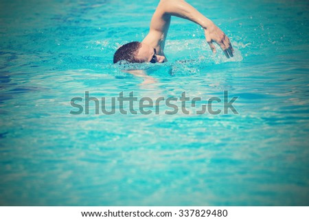 Sportsman swimming in a pool.