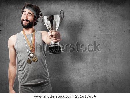 sportsman with medals and cup - stock photo