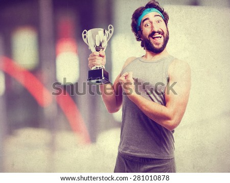 sportsman with winner cup - stock photo