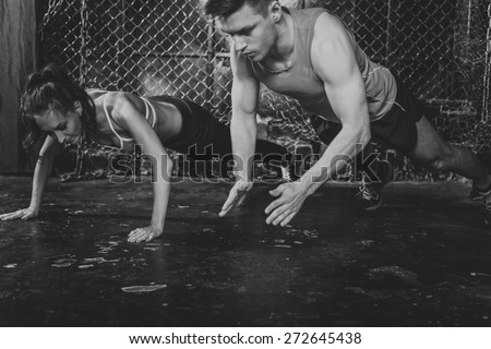 Sportsmen. fit male trainer man and woman doing clapping push-ups explosive strength training concept crossfit fitness workout strenght power. - stock photo