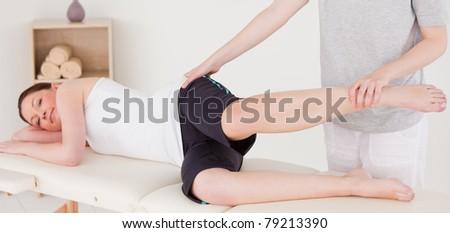 Sportswoman having a leg stretching - stock photo