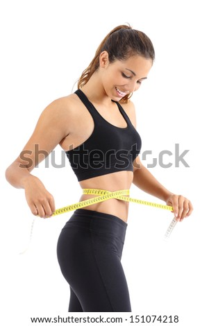 Sportswoman measuring her waist with a measure tape isolated on a white background - stock photo