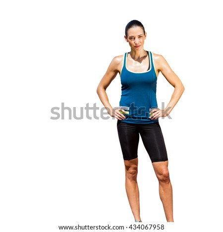 Sportswoman posing on a white background