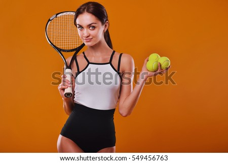 sportswoman with racket and balls in studio. Healthy lifestyle