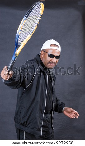 sporty african american senior playing tennis - stock photo