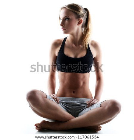 sporty and attractive woman do yoga exercise isolated on a white - stock photo