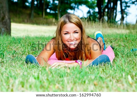 sporty and attractive woman  rest - stock photo