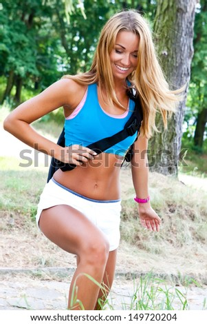 sporty and attractive woman with backpack - stock photo
