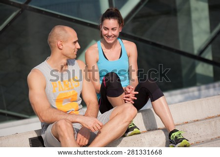 Sporty attractive young couple outdoors. - stock photo