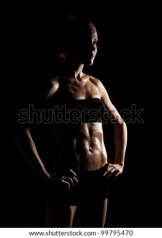 Sporty belly over dark background - stock photo