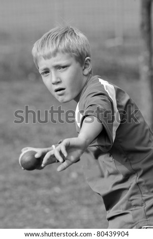 sporty boy fields in cricket game
