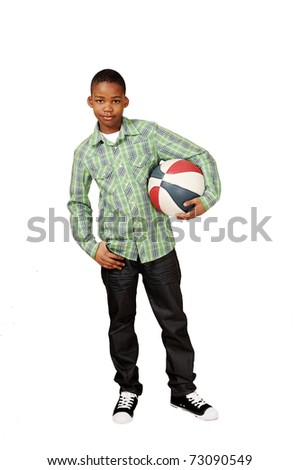 Sporty boy holding a game ball