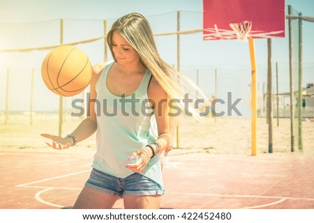 Sporty caucasian girl playing basketball - Sexy blonde girl in a fashion concept - stock photo