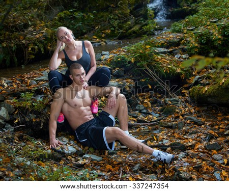 Sporty fitness couple in the park