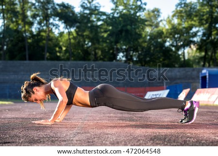 sporty fitness woman push up