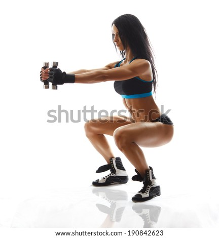 sporty girl doing exercise with dumbbells, silhouette back lit studio shot over white background