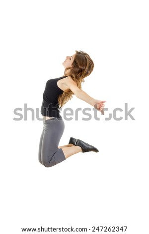 Sporty girl doing stretching exercises. slim hip-hop style teenage dancer dancing.  Weight loss fitness woman jumping of joy. Young sporty fit Caucasian female model isolated on white in full body