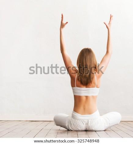 Sporty girl meditating. Yoga exercise. - stock photo