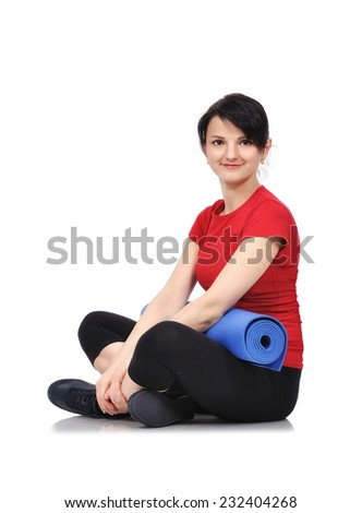 sporty girl sitting with mat for fitness