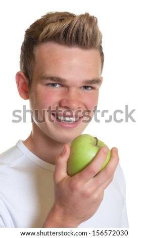 Sporty guy eating an apple  - stock photo