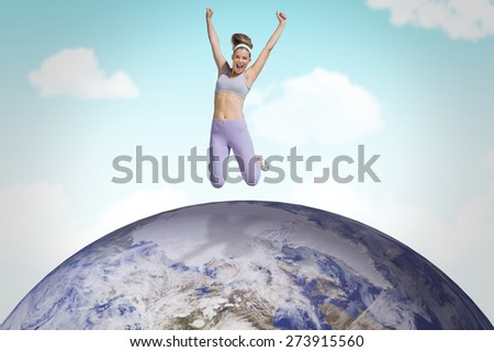 Sporty happy blonde jumping against blue sky - stock photo