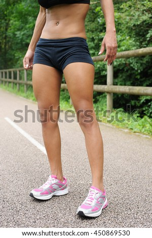Sporty legs of young woman - stock photo