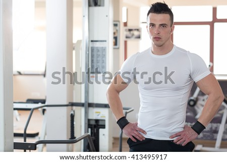Sporty Man Resting In A Gym. Portrait Of A Young Muscular Sporty Fit Caucasian Man